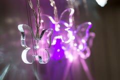 Τρία φωτισμένο κρύσταλλο - σαφή φω'τα πεταλούδων Στοκ Εικόνες
