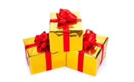 Τρία χρυσά κιβώτια δώρων Στοκ Φωτογραφίες