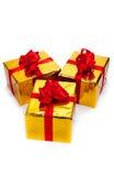 Τρία χρυσά κιβώτια δώρων Στοκ Εικόνες