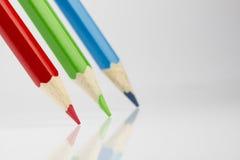 Τρία χρωματισμένα μολύβια στα RGB χρώματα Στοκ εικόνες με δικαίωμα ελεύθερης χρήσης