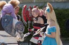 Τρία cosplayers έντυσαν ως χαρακτήρας Elin από το παιχνίδι Tera on-line Στοκ Εικόνες