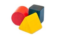 Τρίγωνο, κύλινδρος και τετραγωνικές ξύλινες μορφές Στοκ Εικόνες