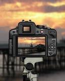 Τρίποδο ηλιοβασιλέματος καμερών στοκ εικόνα με δικαίωμα ελεύθερης χρήσης