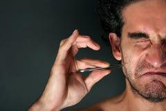 τρίχωμα που τραβά τα τσιμπι&d στοκ φωτογραφία με δικαίωμα ελεύθερης χρήσης