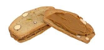 Τραγανές φέτες ψωμιού φυστικιών αμυγδάλων με το βούτυρο μπισκότων Στοκ Φωτογραφία