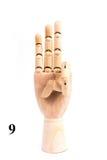 Τραγουδήστε του αριθμού εννέα από το ξύλινο χέρι στοκ εικόνα