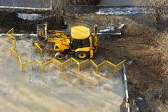 Τρακτέρ κίτρινο Στοκ Φωτογραφία