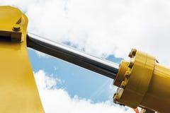 Τρακτέρ υδραυλικής κίτρινο στοκ εικόνες με δικαίωμα ελεύθερης χρήσης
