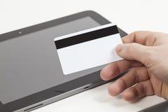 Τραπεζική κάρτα και ταμπλέτα Στοκ Φωτογραφία