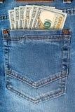 Τραπεζογραμμάτια δολαρίων στην τσέπη τζιν Στοκ Εικόνες