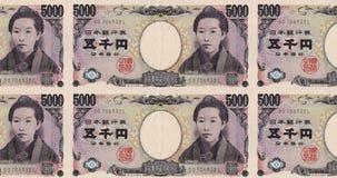 Τραπεζογραμμάτια πέντε του ιαπωνικού κυλίσματος χιλιάες γεν στην οθόνη, χρήματα μετρητών, βρόχος φιλμ μικρού μήκους