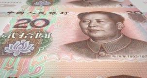 Τραπεζογραμμάτια του κινεζικού κυλίσματος renminbi είκοσι στην οθόνη, χρήματα μετρητών, βρόχος ελεύθερη απεικόνιση δικαιώματος
