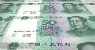 Τραπεζογραμμάτια του κινεζικού κυλίσματος renminbi πενήντα στην οθόνη, χρήματα μετρητών, βρόχος απεικόνιση αποθεμάτων
