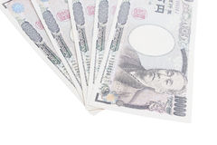 Τραπεζογραμμάτια των ιαπωνικών γεν στο άσπρο υπόβαθρο Στοκ Εικόνες