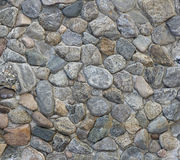 Τραχιά σύσταση του τοίχου πετρών η ανασκόπηση διασταυρώνει τη δύσκολη δομή πετρών βράχου Στοκ εικόνα με δικαίωμα ελεύθερης χρήσης