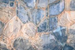 Τραχιά σύσταση υποβάθρου τουβλότοιχος πετρών μαρμάρινη στον τρύγο Στοκ Φωτογραφία