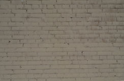 Τραχύς τουβλότοιχος υποβάθρου που χρωματίζεται με το άσπρο χρώμα Στοκ φωτογραφία με δικαίωμα ελεύθερης χρήσης