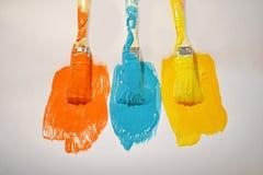 Τρεις βούρτσες στο χρώμα Στοκ Φωτογραφίες