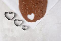 Τρεις κόπτες μπισκότων μορφής καρδιών σε μια γραμμή Στοκ εικόνα με δικαίωμα ελεύθερης χρήσης