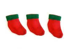 Τρεις μικρές γυναικείες κάλτσες Χριστουγέννων Στοκ φωτογραφία με δικαίωμα ελεύθερης χρήσης