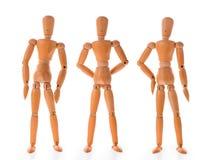 Τρεις ξύλινες κούκλες σε διαφορετικό θέτουν Στοκ εικόνα με δικαίωμα ελεύθερης χρήσης