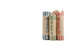 Τρεις ρόλοι της αλλαγής χρημάτων που τυλίγονται στο εμπορευματοκιβώτιο Στοκ εικόνα με δικαίωμα ελεύθερης χρήσης