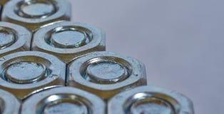 Τρεις σειρές των μπουλονιών και των καρυδιών Στοκ εικόνα με δικαίωμα ελεύθερης χρήσης