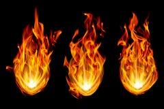τρεις σφαίρες πυρκαγιάς που απομονώνονται στο Μαύρο Στοκ Φωτογραφίες