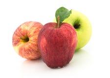 Τρεις Apple στο άσπρο υπόβαθρο Στοκ Εικόνες