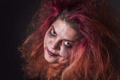 Τρελλή μάγισσα που χαμογελά καταχθόνια Στοκ Εικόνες