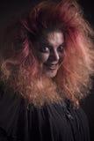 Τρελλή μάγισσα που χαμογελά καταχθόνια Στοκ εικόνες με δικαίωμα ελεύθερης χρήσης