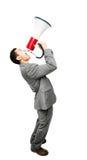 Τρελλός ασιατικός επιχειρηματίας που κραυγάζει megaphone στο άσπρο backgrou Στοκ φωτογραφία με δικαίωμα ελεύθερης χρήσης