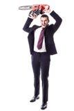 Τρελλός επιχειρηματίας με ένα αλυσιδοπρίονο Στοκ Φωτογραφία