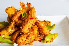 Τριζάτες γαρίδες με το πιπέρι και το κρεμμύδι Στοκ Εικόνες