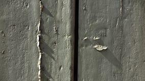 Τριζάτη σκιά στην πόρτα Στοκ Φωτογραφίες