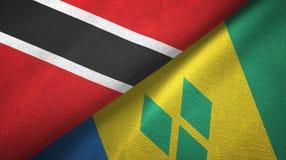 Τρινιδάδ και Τομπάγκο και Άγιος Βικέντιος και Γρεναδίνες δύο υφαντικό ύφασμα σημαιών ελεύθερη απεικόνιση δικαιώματος