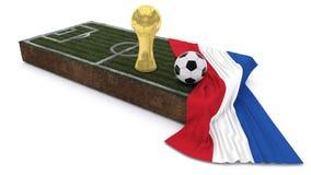 τρισδιάστατα σφαίρα και τρόπαιο ποδοσφαίρου στο μπάλωμα χλόης με τη σημαία Στοκ Φωτογραφία