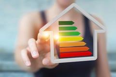 Τρισδιάστατη απόδοση έννοιας σπιτιών eco επιχειρηματιών Στοκ φωτογραφία με δικαίωμα ελεύθερης χρήσης