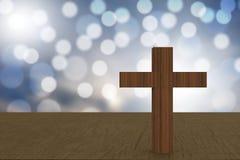 τρισδιάστατη απόδοση του ξύλινου σταυρού μπλε bokehs σε έναν πίνακα ελεύθερη απεικόνιση δικαιώματος