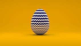 τρισδιάστατο αυγό Πάσχας με το άσπρο και μπλε σχέδιο στο πορτοκαλί υπόβαθρο Στοκ φωτογραφίες με δικαίωμα ελεύθερης χρήσης