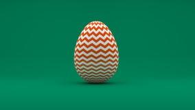 τρισδιάστατο αυγό Πάσχας με το άσπρο και πορτοκαλί σχέδιο στο πράσινο υπόβαθρο Στοκ εικόνα με δικαίωμα ελεύθερης χρήσης