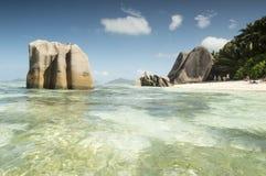 Τροπική πηγή D'Argent Anse παραλιών στο νησί Λα Digue, Σεϋχέλλες - υπόβαθρο διακοπών Στοκ Φωτογραφία