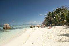 Τροπική πηγή D'Argent Anse παραλιών στο νησί Λα Digue, Σεϋχέλλες - υπόβαθρο διακοπών Στοκ εικόνα με δικαίωμα ελεύθερης χρήσης