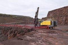 Τρυπάνι σε ένα ορυχείο λατομείων porphyry βράχοι Στοκ Εικόνα