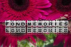 Τρυφερό κείμενο μνημών με τα λουλούδια Στοκ Εικόνα