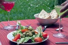 Τρόφιμα με τα χέρια Στοκ Εικόνες
