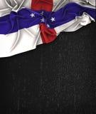 Τρύγος σημαιών Ολλανδικών Αντιλλών σε έναν μαύρο πίνακα κιμωλίας W Grunge Στοκ Εικόνα