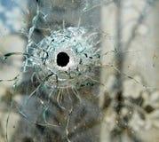 Τρύπα από σφαίρα σε ένα παράθυρο Στοκ Φωτογραφίες