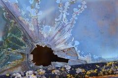 Τρύπα από σφαίρα στο γυαλί Στοκ Φωτογραφίες