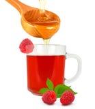 Τσάι σμέουρων με το μέλι στοκ εικόνες
